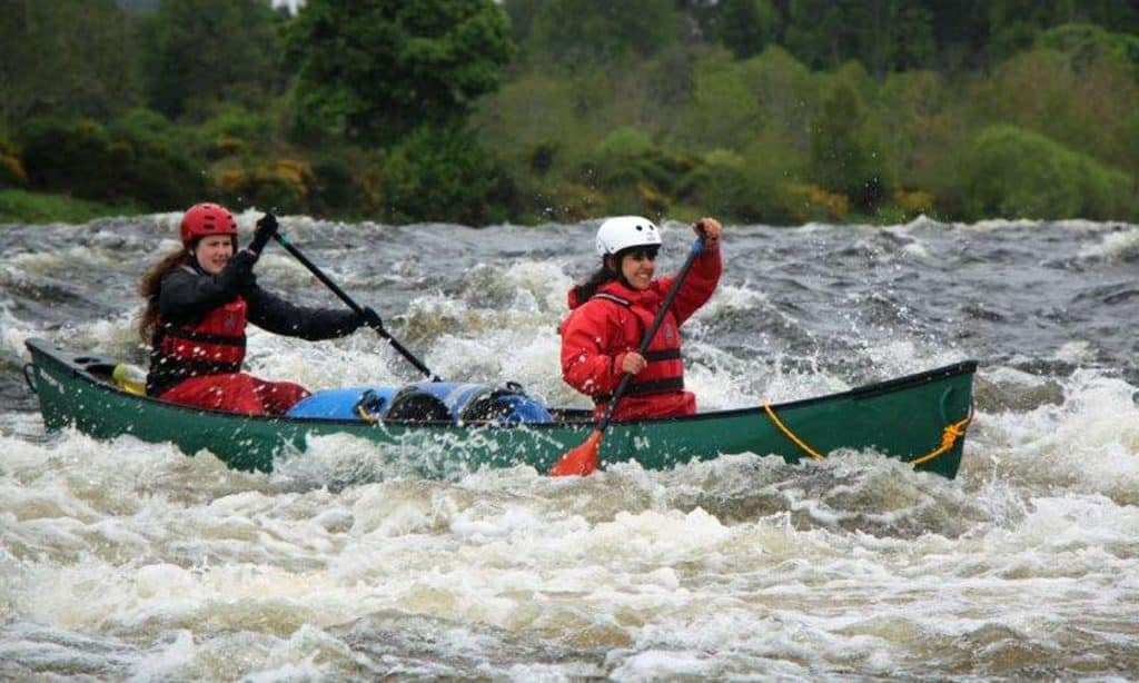 Canoeing on river spey white water