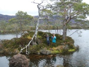 The loch on an island in a loch on an island in a loch on an island! Their feet are almost in it.
