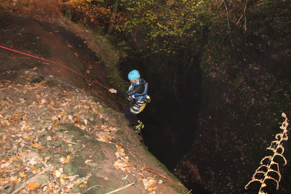 abseiling into a canyon