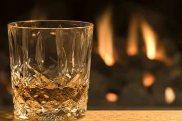 whisky glass by a fire