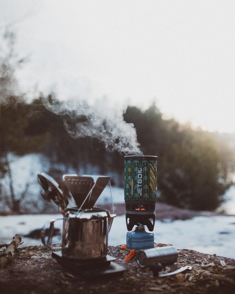 Camp stove for hot drinks on winter's day. Photo by Kyle Peyton on Unsplash